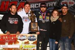 """Robert Ballou of Rocklin, California celebrates with his crew after winning Thursday's night one of the """"Western World Championships"""" at USA Raceway. (Rich Forman Photo)"""