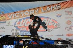 Justin Russell, with son Blaine, after a victory during the 2015 season. - Photo by CB Race Photos