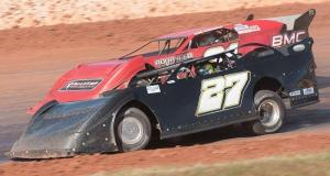 David Smith of Inman, SC in the #27 Upstate Wholesale Cars Special and Cale Conley of Davidson, NC battle side-by-side for the lead on Sunday afternoon in the 50-lap race of the RockAuto.com Winter Shootout for the NeSmith Chevrolet Dirt Late Model Series at Golden Isles Speedway in Brunswick, GA.  Smith was able to edge Conley by a half car-length at the checkered flag for the $3,000 victory.  (NeSmith Media Photo by Bruce Carroll)