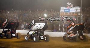 Brad Sweets edges Daryn Pittman and David Gravel to win at Cotton Bowl Speedway. - Tim Aylwin photo.