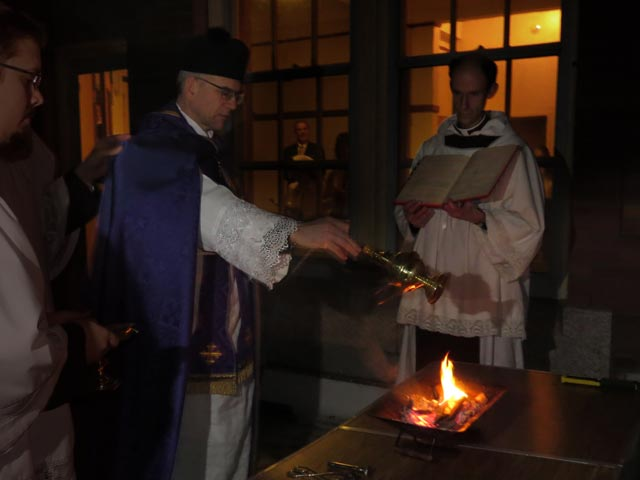Father incenses the Easter fire