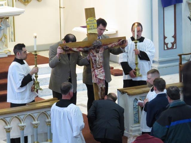 Good Friday: The faithful venerate the cross.