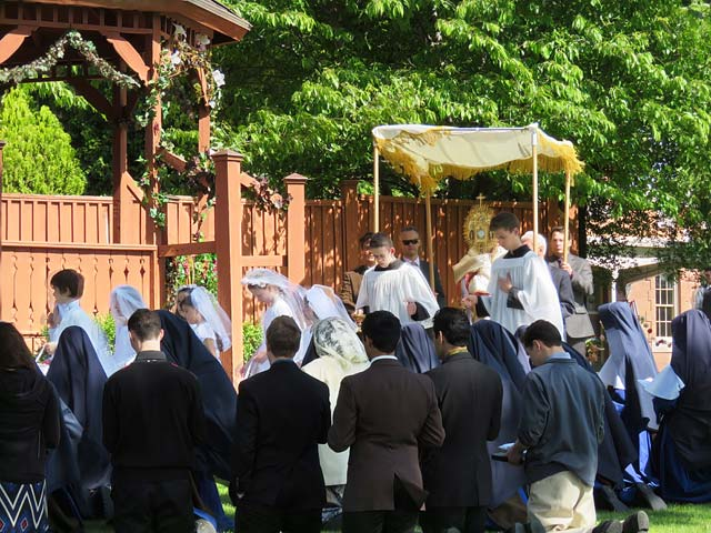 The Blessed Sacrament carried in procession on Corpus Christi