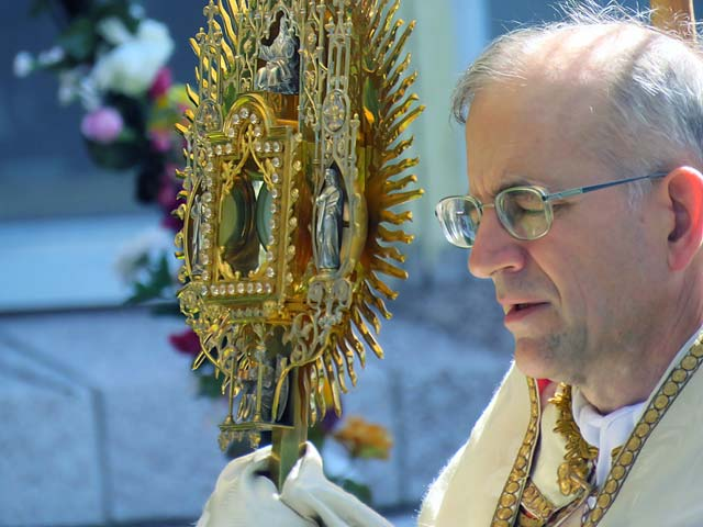 Fr. Casimir carries the montrance