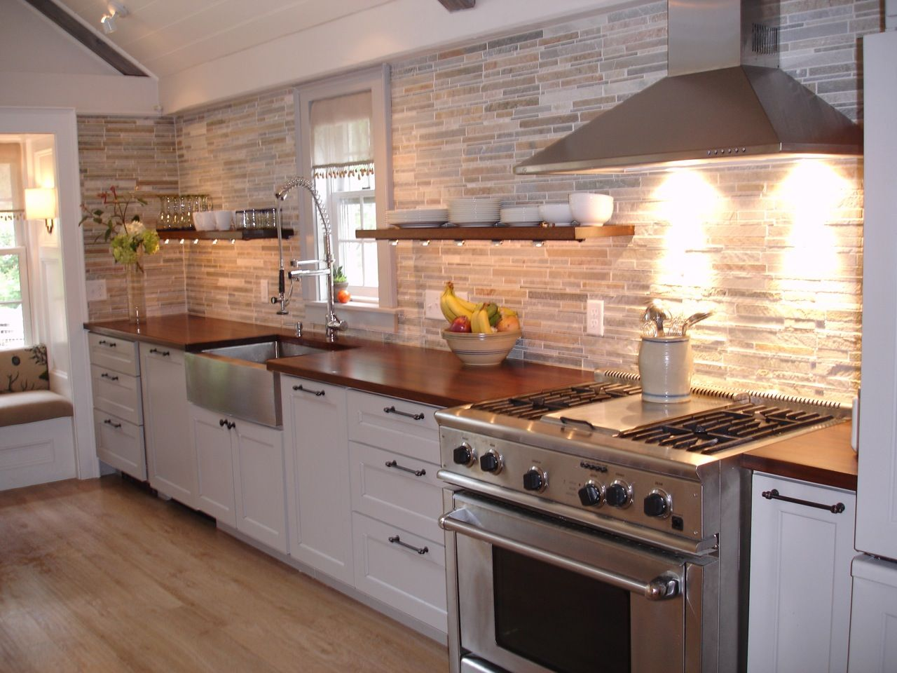 how to choose a wood countertop for your kitchen wood countertops kitchen Mahogany wood countertop provides a warm contrast to stainless steel and white shaker kitchen cabinets