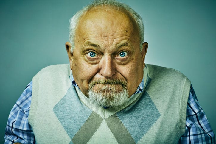 63792329 - angry disgruntled elderly man face expression close-up.