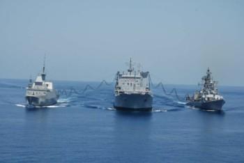 INS Jyoti refuels INS Ranvir and RSNS Intrepid at sea.