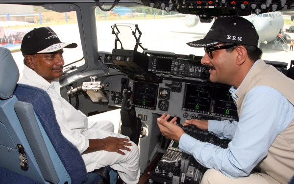 A seemingly indulgent AK Antony in the cockpit of the aircraft with an animated Jitendra Singh, who has a keen interest in aviation   DPR, Defense Ministry