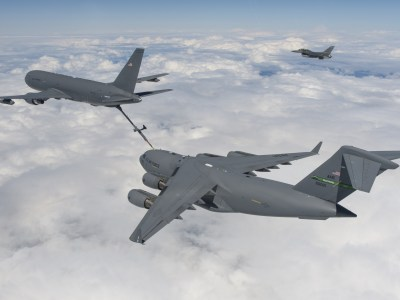 A KC-46 refuels a C-17 Globemaster III as an F-16 keeps watch | Photo: Boeing