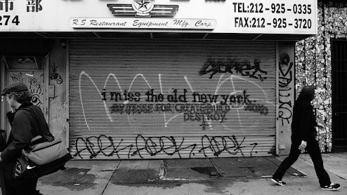 i miss the old new york graffiti on a closed gate on bowery