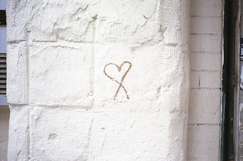a graffiti heart found on a wall in nyc