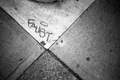 faust carved into the sidewalk of nyc