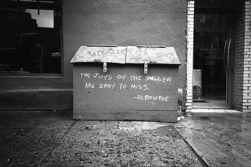 the joys of the sullen are easy to miss - street art graffiti by elbow toe