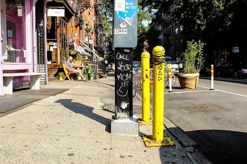 graffiti that reads call your mom found in the east village of NYC