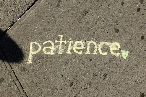 chalk street art graffiti that reads patience found in NYC