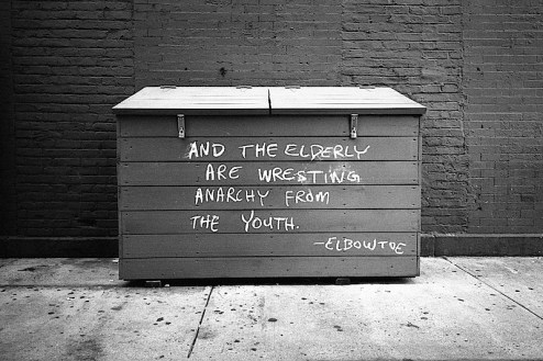 and the elderly are wrestling anarchy from the youth by elbow toe found in the east village of NYC