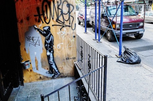 street art by icy and sot outside of black and white bar in NYC