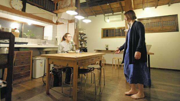 COMMUNAL LIVING: Foreign guests relax in a guesthouse in Tokyo, that was renovated from a 90-year-old Japanese house ...