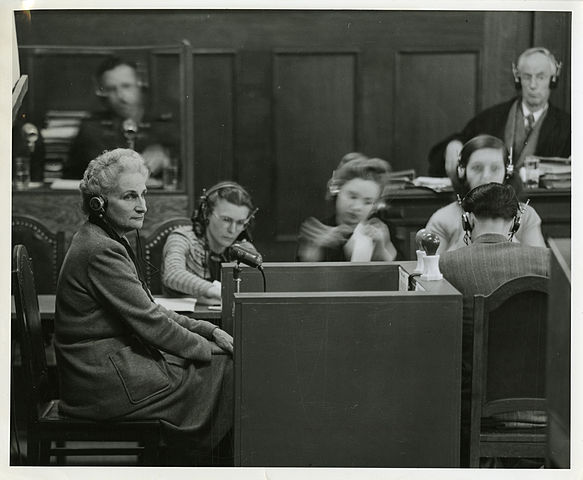 A photograph of Hanna Solf giving witness testimony at the Nuremberg Trials.