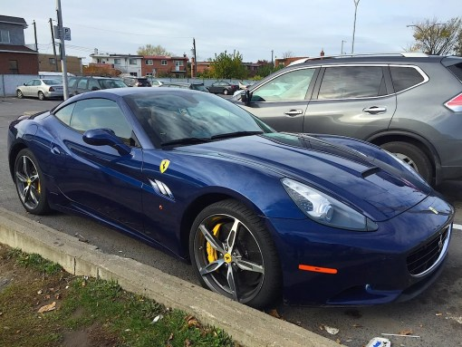 Well parked blue Ferrari