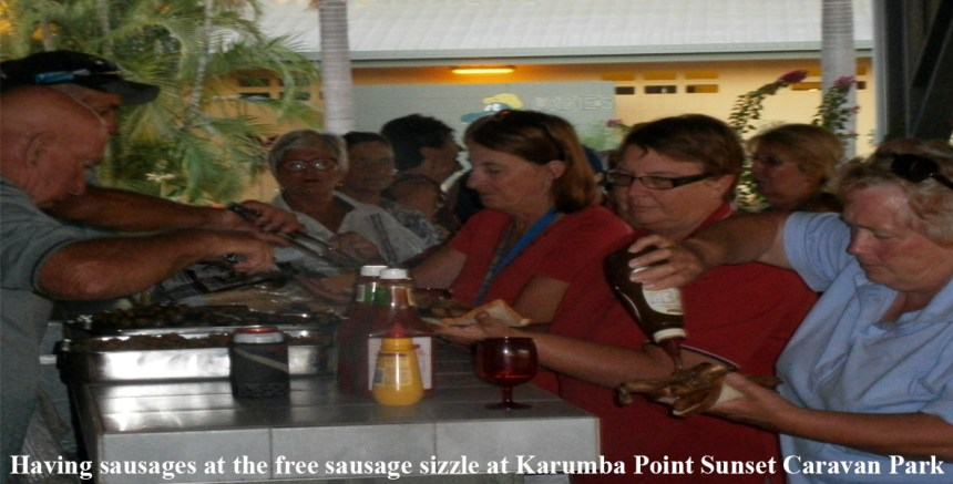 Having-sausages-at-the-free-sausage-sizzle-at-Karumba-Point-Sunset-Caravan-Park