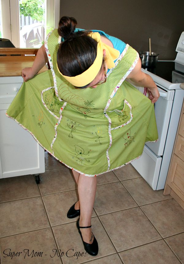 Middle daughter taking a bow in Thanksgiving apron