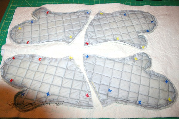 Inside of old oven mitts pinned to the back of the quilted fabric