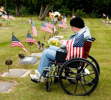 Veteran at cemetary on Memorial Day