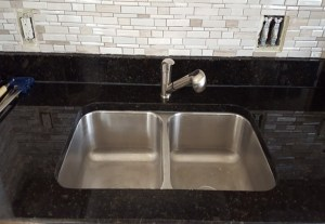 double bowl, stainless steel sink, double bowl sink, retattached sink, sink services, sink repair, surface link, granite countertops, granite repairs