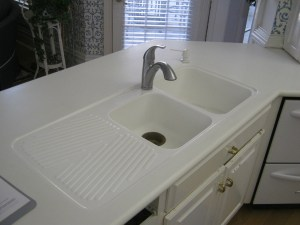 Before: Crack in a Double Corian Sink with Drainboard Installed