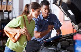 Auto mechanic with customer