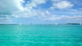 Traditional Bahamian sloops on neon water
