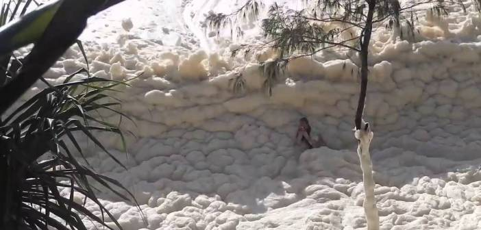 Video: Swimmer gets caught in sea of foam during Gold Coast storm