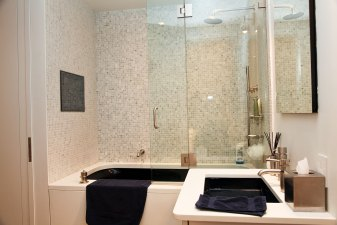 Bathroom comes equipped with a jacuzzi tub, top of the line fixtures and hardware, and a waterproof television.