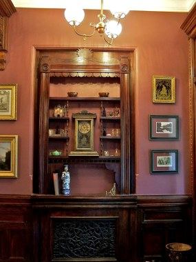 Greene St. Brownstone-A shelving unit was custom built for entry niche. All pieces including carvings,scalloping were done in the shop. A cast iron grill was incorporated into the design with much success.