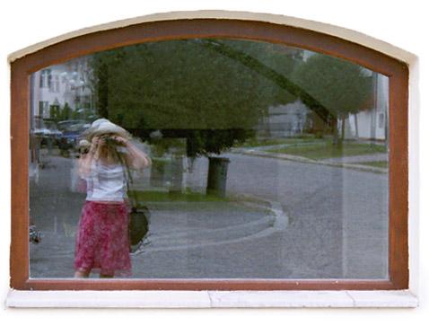 Taliya Finkel mirrored in window