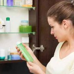 44152682 - beautiful girl choosing beauty products from the bathroom cabinet