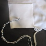 Tzitzit tucked in or showing?