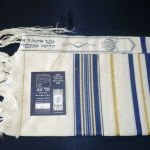 Tallit with blue and gold striping