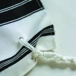 Chabad tzitzis holes