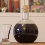 drunken prune liqueur in glass bottle