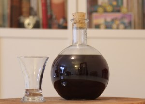 drunken prune liqueur in glass bottle