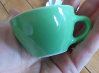 duktig tea cup in palm of hand