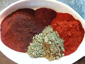 Clockwise from top: Chipotle Chile Powder; Paprika; ground Cumin; Mexican Oregano; Ancho Chile Powder.