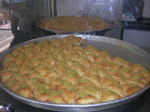 Trays of knafeh in Amman, Jordan. I could've sat there all day eating this.