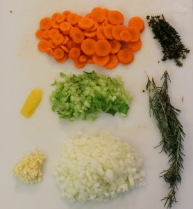 The produce: Starting from top left - lemon zest, garlic; middle, from top - carrots, celery, onion; right, from top - thyme, rosemary