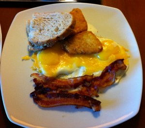 Steve's Breakfast: Coffee, Orange Juice, Eggs with Cheese (American Style, they called it), Bacon, Hash Browns, Toast.