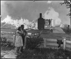 A couple watch homes burn in the 1967 Tasmanian bushfires.