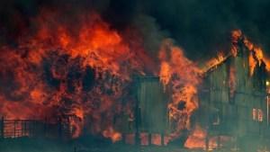 The Tasmanian bushfire of 2013 burns a farming shed
