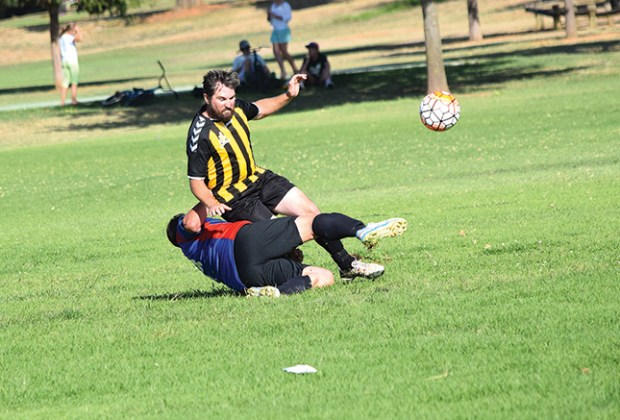 Mick Gray is felled by a Northern Riverina defence during the Eagles' big win last Sunday at Forest Hill.